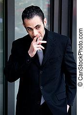 Business man smoking - Secret surveillance photo of a...