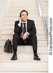 Business man speaking on cellphone