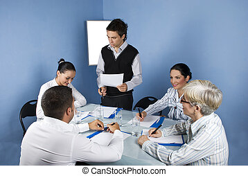 Business man speech - Meeting of business people in a office...