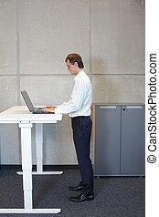 business man standing at desk