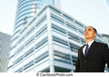 Business Man Standing By Modern Building