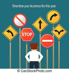business man standing in front traffic signs