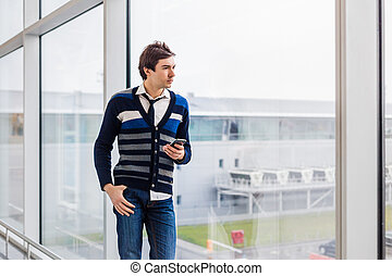 Business man standing next to office window