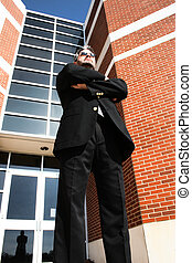 Business Man Standing Outside