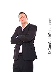 business man standing with arms folded