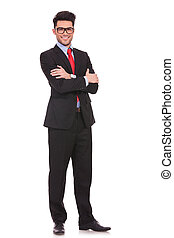 business man standing with hands folded
