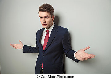 business man standing with his arms open