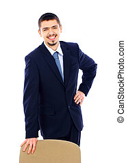 business man standing with office chair over white background
