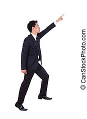 business man stepping up and pointing to target isolated on white