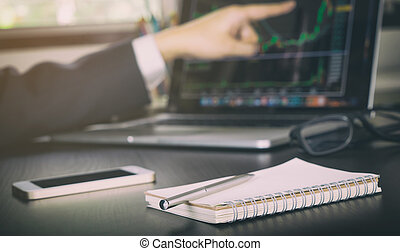 Business man stock trader pointing at diagram screen