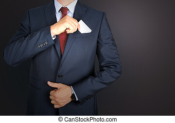 business man taking out business card from the pocket of business suit