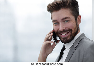 Business man talking on mobile phone - Happy bearded...