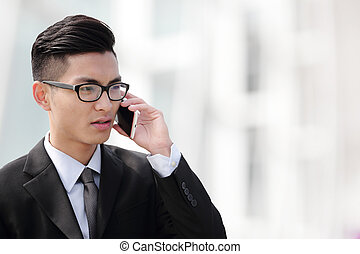 Business man talking on smart phone