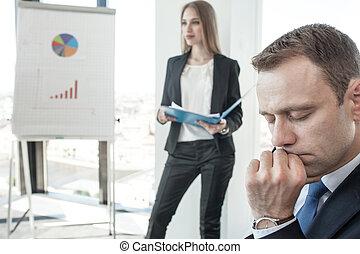 Business man thinking at meeting