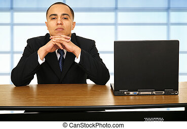 Business Man Thinking Over His Laptop