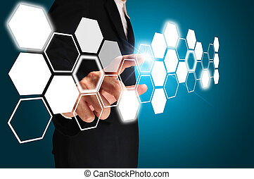 Business man touching an imaginary screen on blue background