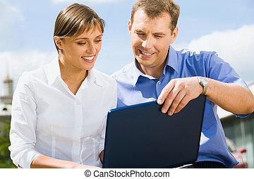 Business man trains his colleague