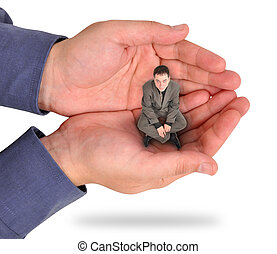 A business man is sitting in the palm of his bosses hand on a white background. He looks unhappy and feels trapped and weak at his job. Use it for a strength or struggle concept.