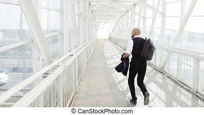 business man traveler running in hurry in the airport or to...