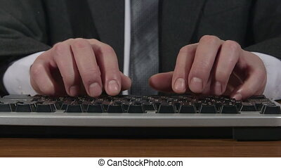 Business man typing on keyboard