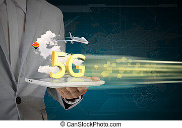 Business Man use Tablet PC on 5G High speed network...