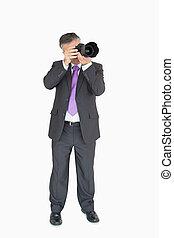 Business man using a camera