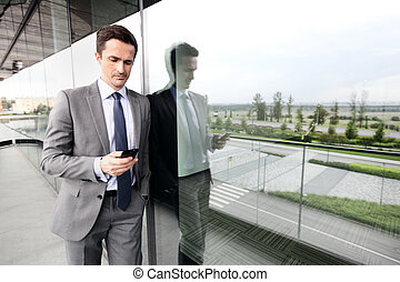 Business man using cell phone