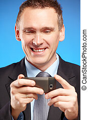 Business man using his mobile phone