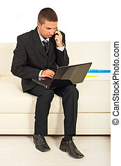 Business man using laptop and cellphone