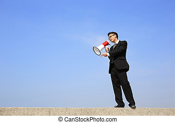 business man using megaphone