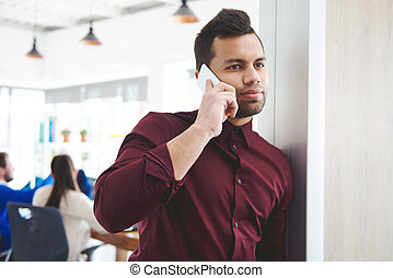 Business man using smartphone at work