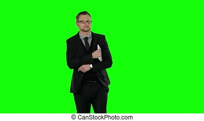 Business man walking and use laptop. Green screen.