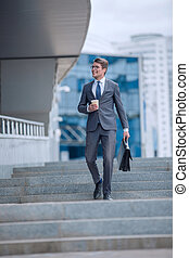 business man walking down the street of a big city