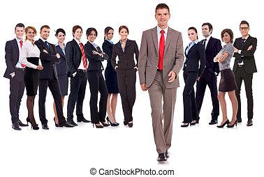 business man walking forward leading team