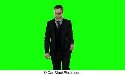 Business man walking. Green screen.