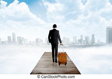Business man walking in the pier