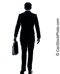 business man walking rear view silhouette
