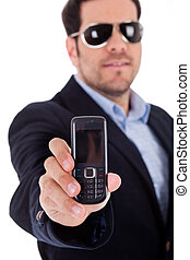 Business man wearing sunglasses and showing a Nokia mobile