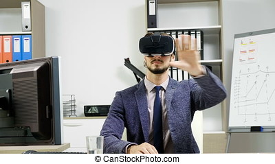 Business man wearing virtual reality googles / VR Glasses in...