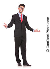 full length picture of a young business man wellcoming everybody with his arms wide opened and with a large smile on his face, on white background