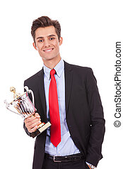 business man winner holding a cup trophy