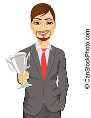 business man winner holding a silver cup trophy