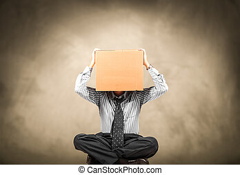 man with a carton box on the head