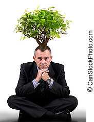 man with a tree on the head