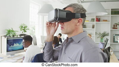 Business man with a virtual headset - Side view of a ...