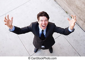 business man with arms outstretched