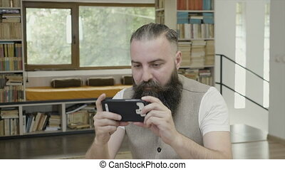 Business man with beard wearing casual outfit sitting in the...