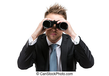 Business man with binocular - Business man wearing suit with...