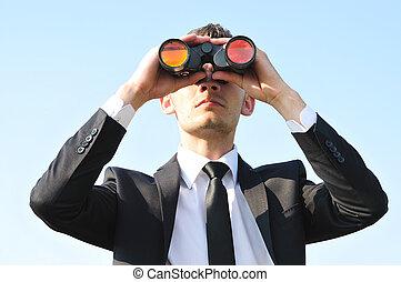 Business man with binoculars