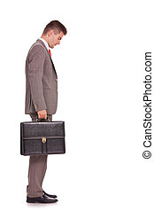 business man with briefcase looking down